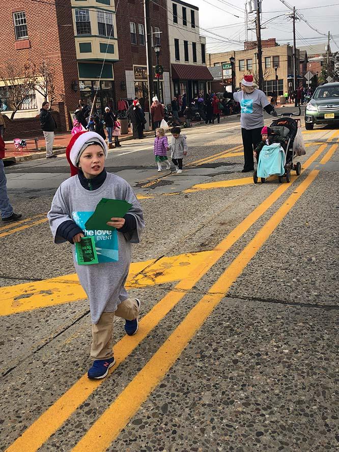 Child walking on yellow line