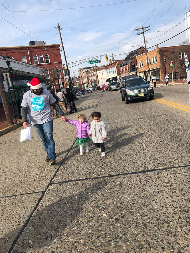 Mike walking with two little girls