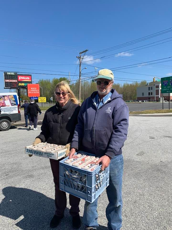 DanLyn Farms - carrying crates of donated eggs