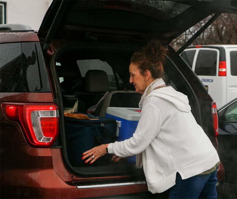 Nicki Burke loading her car