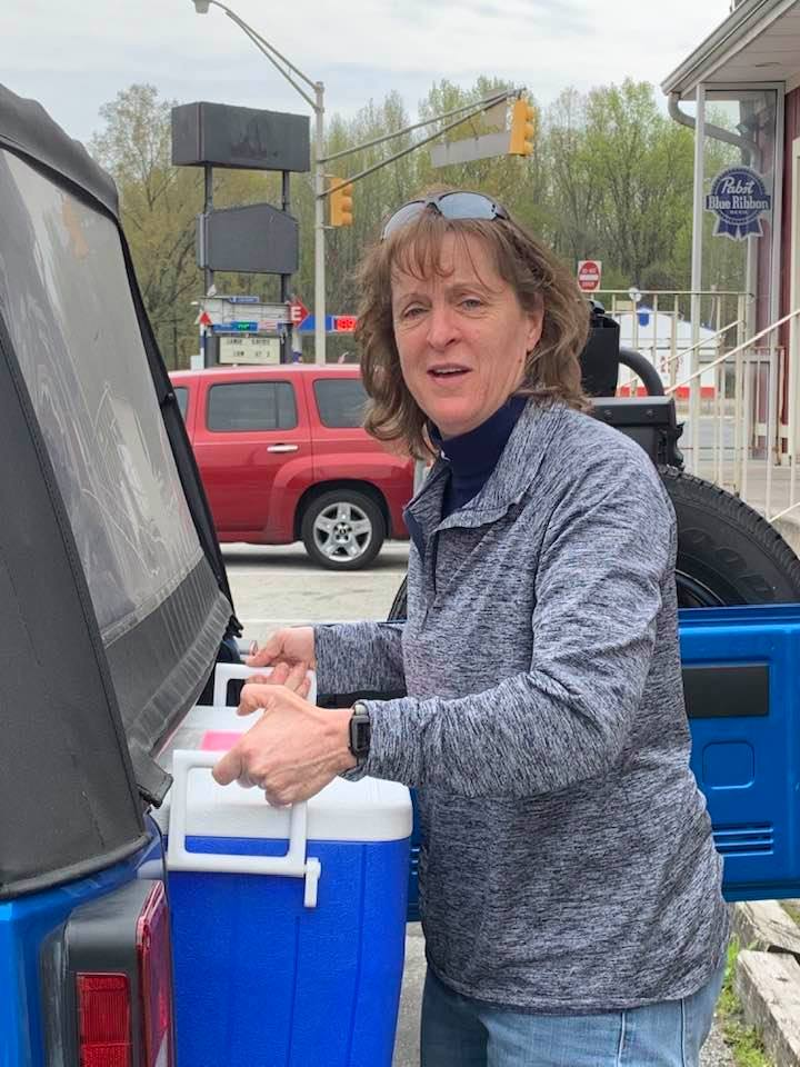 Sheila Burris loading cooler into her vehicle