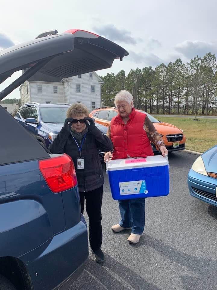 Priscilla & Karen Sparks loading up their car