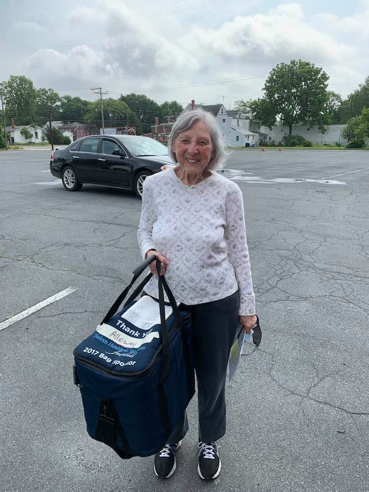 Jeanette Finlaw holding bag in a parking lot