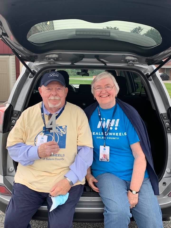 Bill and Connie Clark sitting in trunk of SUV