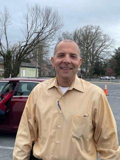 John Pelura outside in parking lot