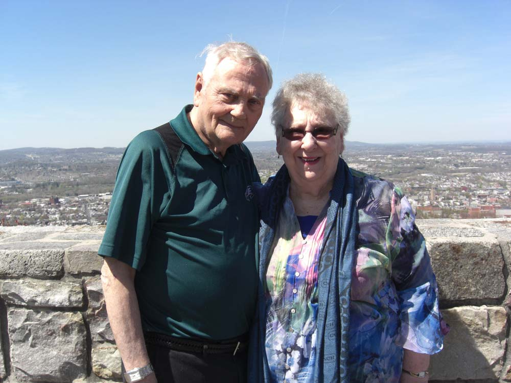 Nancy and Al Mossop posing for photo infront of scenic view