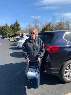 Vicki Price standing infront of car in parking lot